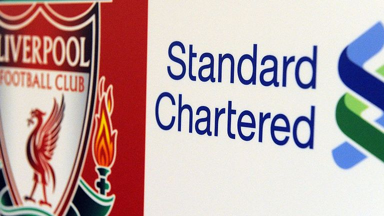 The logos of Liverpool football club (L) and Standard Chartered Bank (R) are pictured after Liverpool agreed a sponsorship deal with Standard Chartered bank at Anfield, in Liverpool, north-west England on September 14, 2009. Liverpool football club announced late Sunday a sponsorship deal with British bank Standard Chartered, the largest in the club's history, according to a statement on its website. The club said the four-year deal starting in 2010 was the