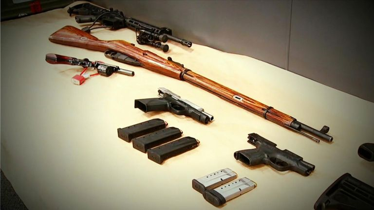 Police said an assault rifle was among the weapons discovered
