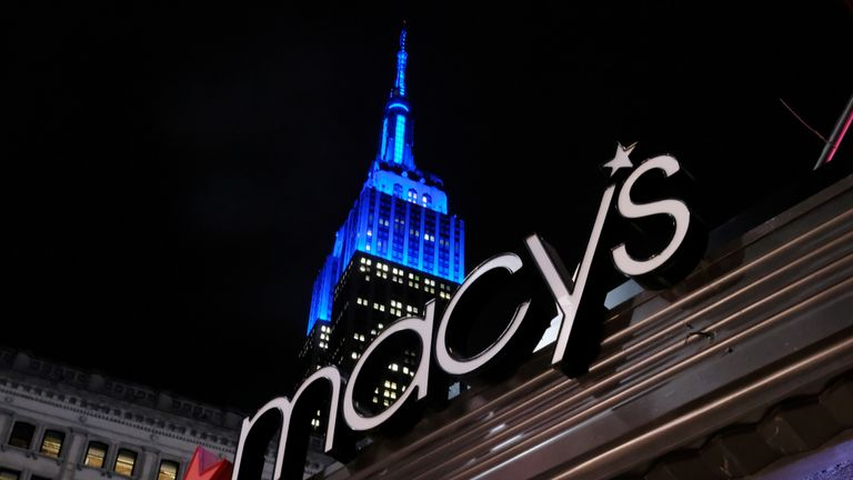 FILE PHOTO: The front entrance sign of Macy's Herald Square in New York 14 November 2016