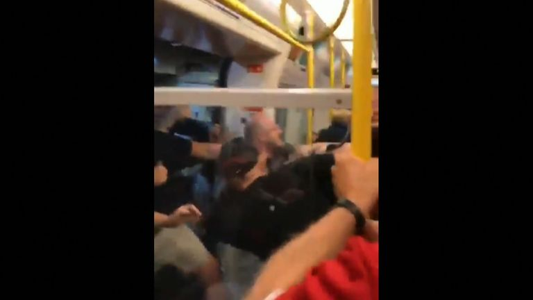 Seven people were taken into custody after a mass brawl broke out on a London Underground train between Manchester City and Liverpool fans.