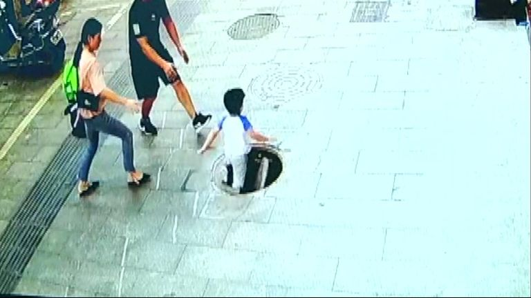 A little boy got the shock of his life after he stamped on a broken manhole cover and fell into a well in Guizhou Province in China.