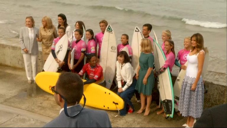 The spouses of G7 leaders, including Melania Trump and Brigitte Macron, took a stroll at the beach to meet youth surfers in Biarritz.