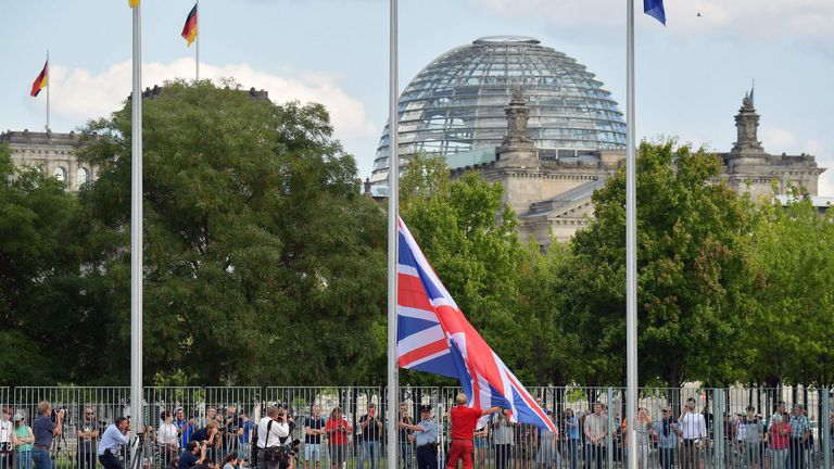 The British flag is raised outside the Bundestag in Berlin
