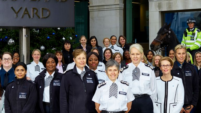 Khafi Kareem pictured behind Cressida Dick as the Met celebrated 100 years of female officers
