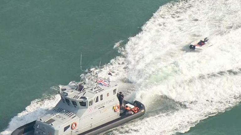 A dinghy which had been carrying migrants is towed into Dover