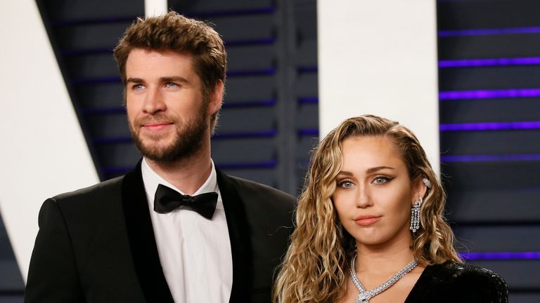 1st Academy Awards – Vanity Fair – Beverly Hills, California, U.S., February 24, 2019 – Liam Hemsworth and Miley Cyrus. REUTERS/Danny Moloshok