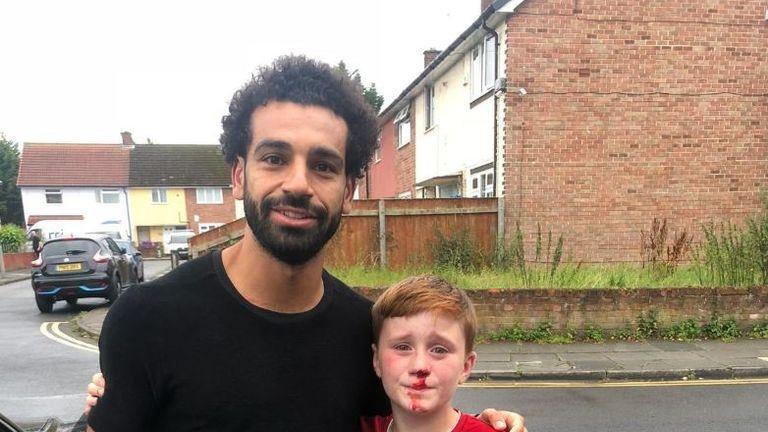 Mo Salah poses with 11-year-old Louis Fowler. Pic: Joe Cooper