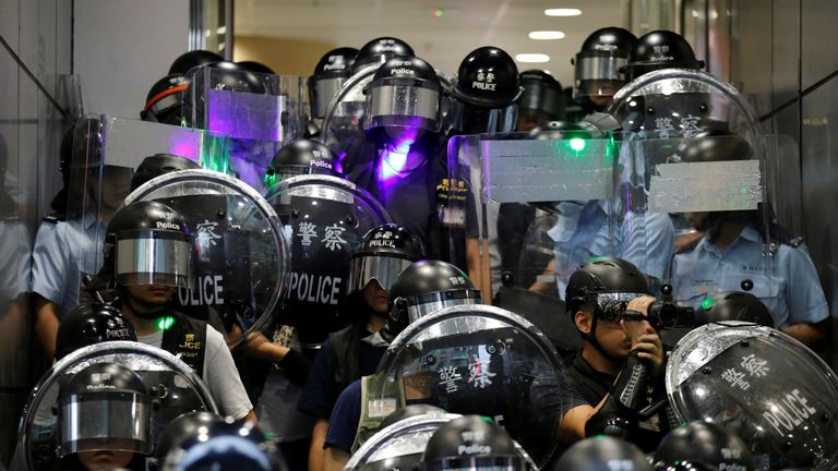 Riot police warn protesters at Mong Kok police station to clear the area