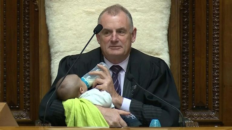 Speaker Trevor Mallard holding a lawmaker's newborn son in the House of Representatives.