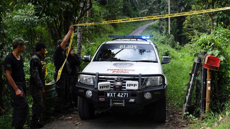 A police vehicle is seen at an entrance to the Dusun Resort, where the missing 15-year-old Franco-Irish teenager Nora Quoirin was last seen