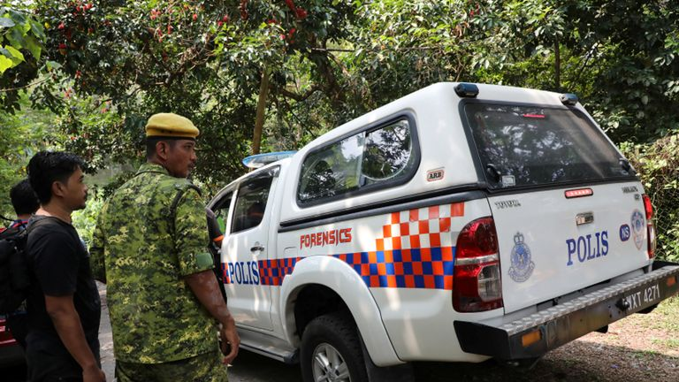 A police forensic vehicle enters the Dusun Resort where Nora Quoirin went missing