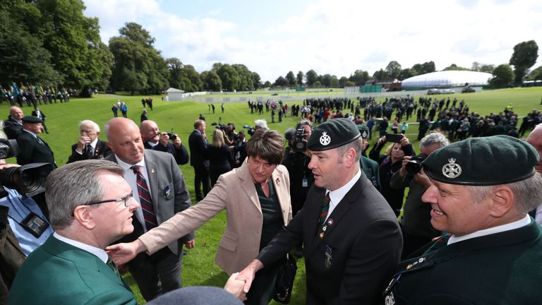 Sir Jeffrey Donaldson (left) and Arlene Foster, meet veterans during an event to mark the Op Banner anniversary