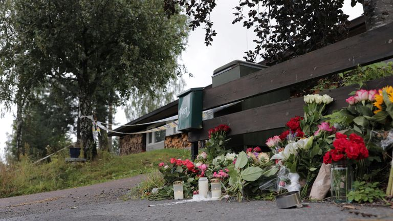 Flowers left outside the suspect's house in Oslo after his stepsister was found dead.