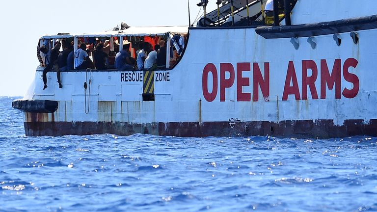 Stranded migrants jump off rescue boat to try to reach Italy