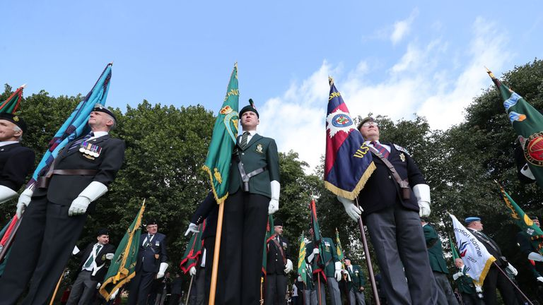 Veterans display regimental banners during the Operation Banner commemoration