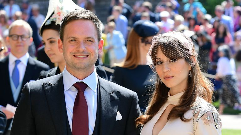 Suits actor Patrick J Adams and wife Troian Bellisario at Windsor Castle before the wedding of Prince Harry to Meghan Markle on May 19, 2018