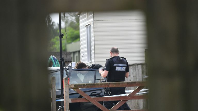 Police at a caravan site near Burghfield Common in Berkshire