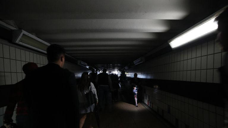 The power cut plunged travellers into darkness at Clapham Junction station