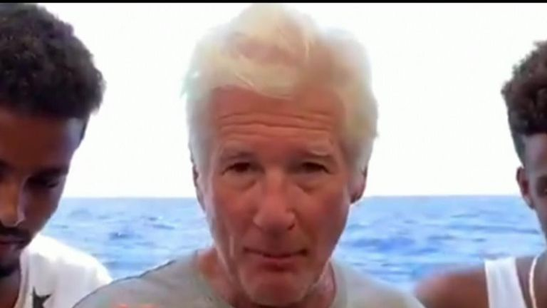 Richard Gere joins migrants on a boat in the Mediterranean