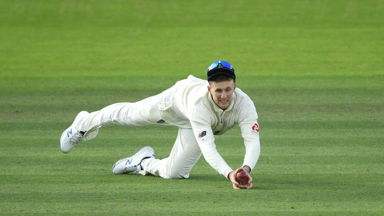 England captain Joe Root dives to catch Aussie batsman Marnus Labuschagne