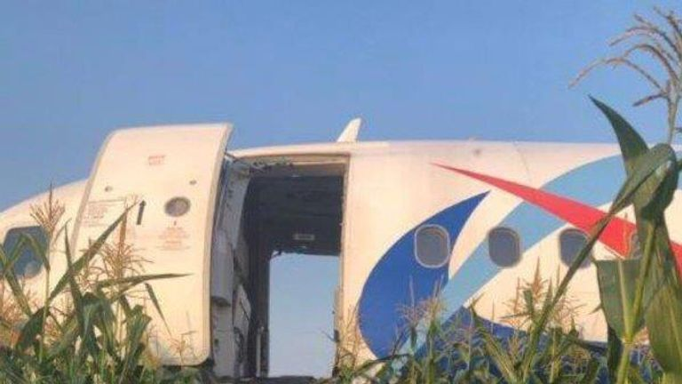 The pilot made an emergency landing in a cornfield about half a mile from the airport