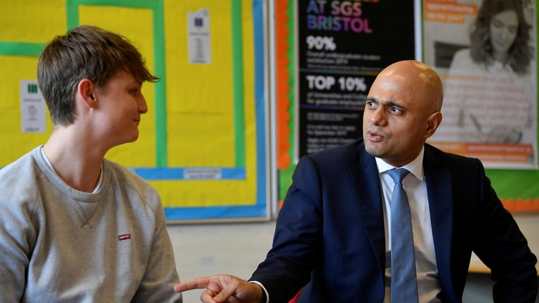 Sajid Javid speaks with students during a visit to SGS College Filton, where Javid himself studied