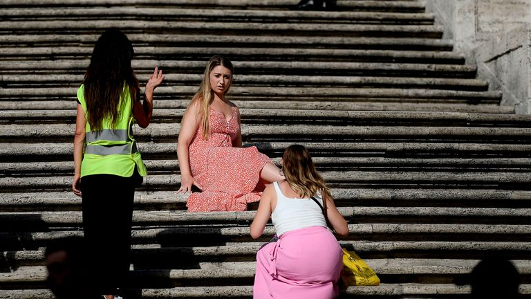 Tourists are told to move on from the famous steps