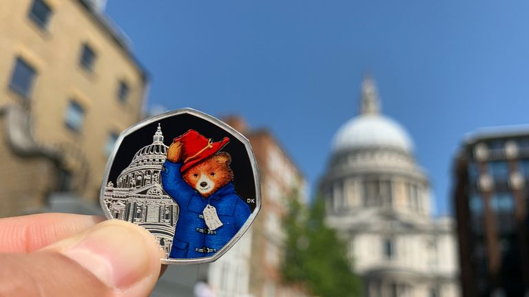 One of the coins shows Paddington next to St Paul's Cathedral