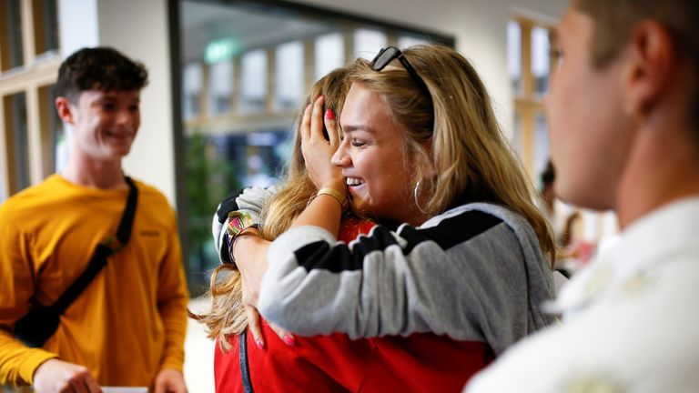 Sixth form students react as they receive their A-Level results