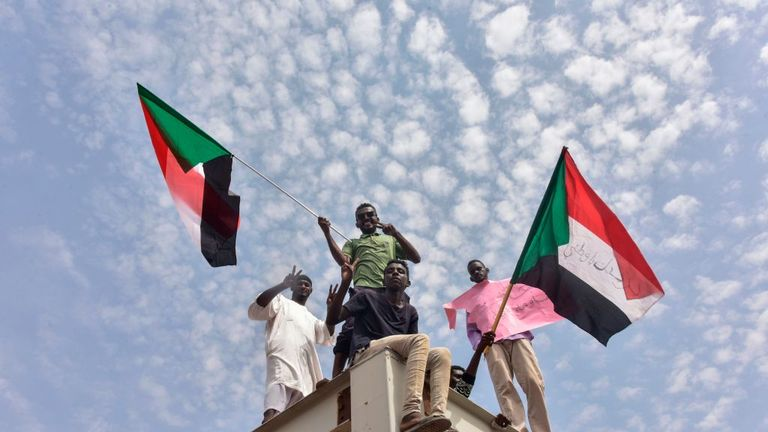 Sudanese protesters from the city of Atbara celebrate transition to civilian rule