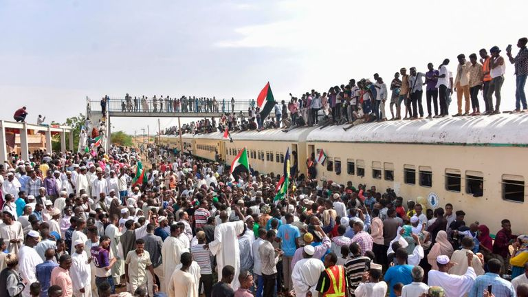 Sudanese protesters from the city of Atbara arrive at the Bahari station in Khartoum