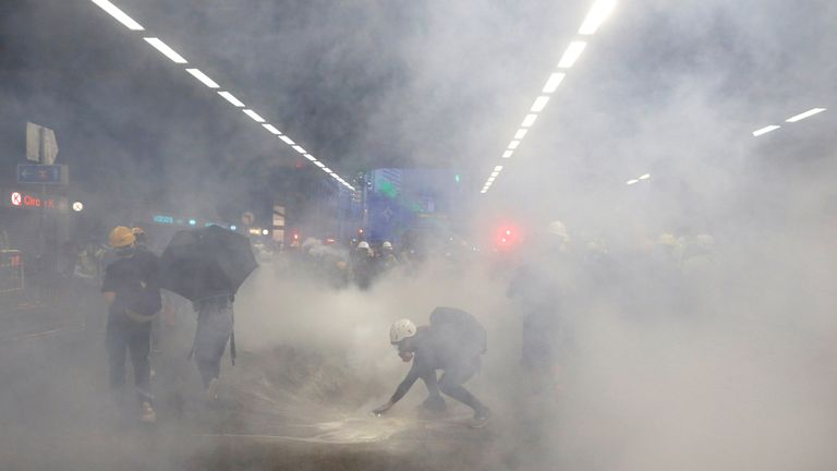 Tear gas was fired after a standoff between police and protesters at a railway station