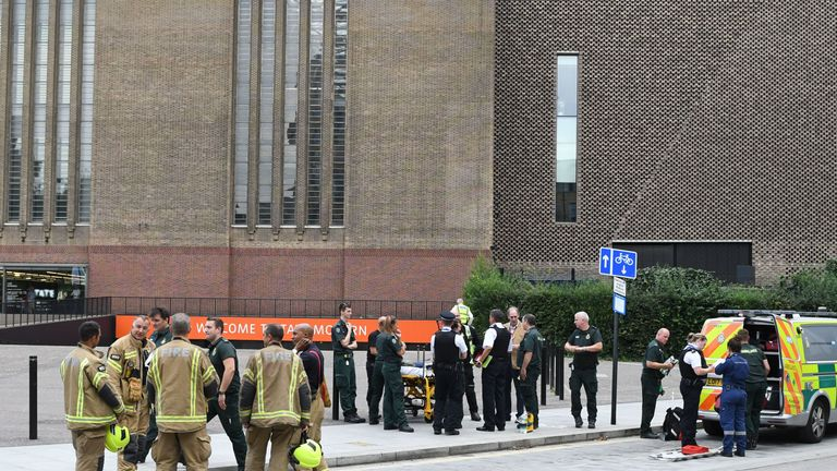 "Police, ambulance crews and fire crews are seen outside the Tate Modern gallery in London on August 4, 2019 after it was put on lock down and evacuated after an incident involving a child falling from height and being airlifted to hospital. - London's Tate Modern gallery was evacuated on Sunday after a child fell ""from a height"" and was airlifted to hospital. A teenager was arrested over the incident, police said, without giving any details of the child's condition. (Photo by Daniel SORABJI / AF"