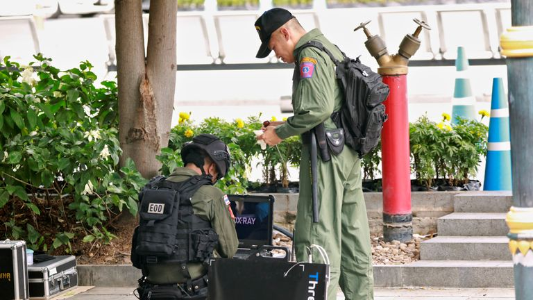 Bomb disposal officers at the scene of one of the blasts