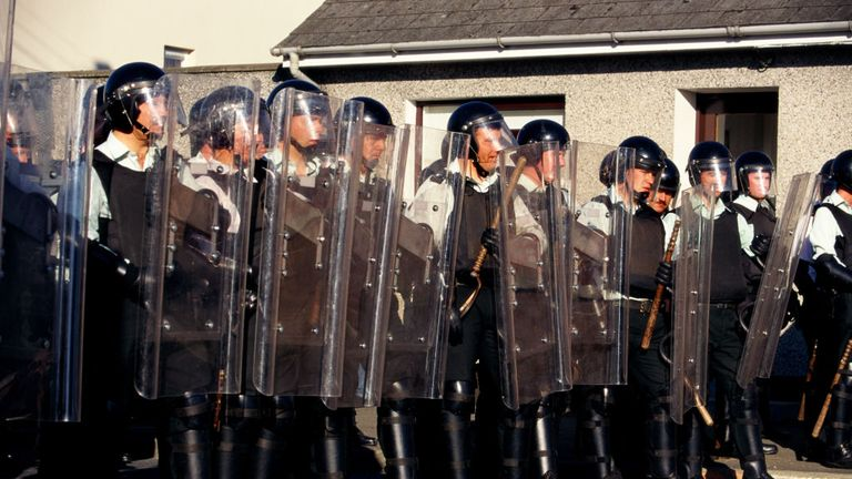 RUC officers with riot shields in Bellaghy, Northern Ireland, during a stand off between Catholics and Protestants during the annual marching season