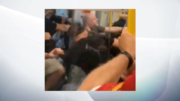 Punches and kicks were thrown at the door of an underground train. Pic: @StevePatten