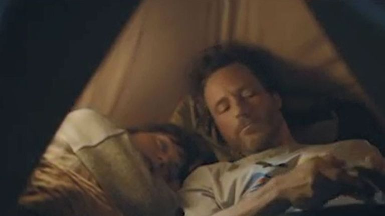 The advert for the Volkswagen eGolf car, showing a sleeping woman and a man in a tent