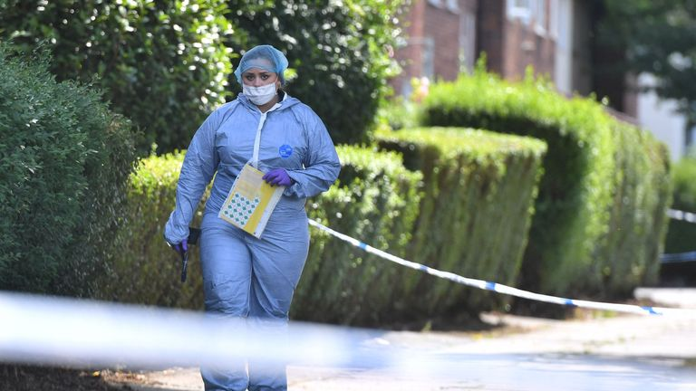 A forensic officer in the Waltheof gardens in Tottenham
