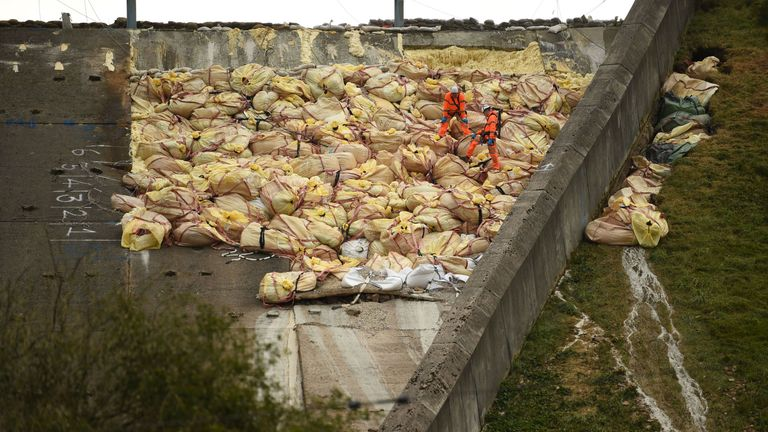 The damaged dam has been packed with bags of aggregate to prevent it from collapsing