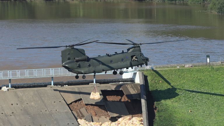 The RAF Chinook hovered low above the dam as is tried to repair the damage