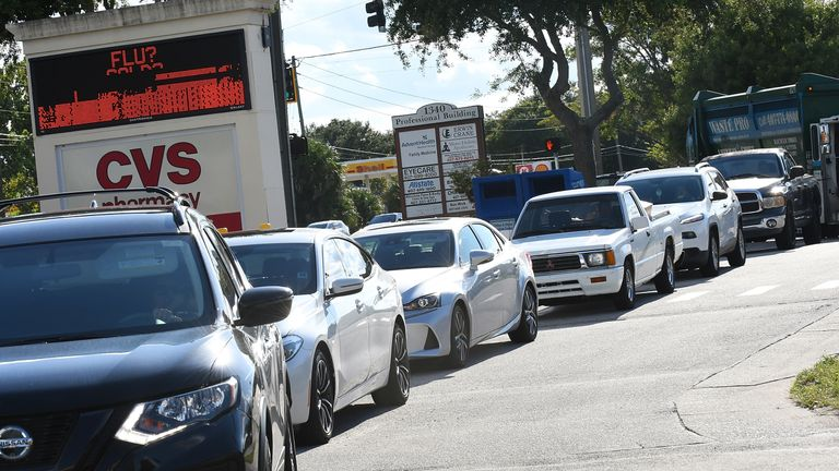 Motorists in Winter Springs, Florida, queue to fill up on petrol before the storm hits