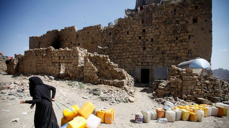 A woman displaced from the Red Sea port city of Hodeidah pulls empty canisters outside her family shelter in Sanaa, Yemen November 2, 2018. Picture taken November 2, 2018. REUTERS/Mohamed al-Sayaghi