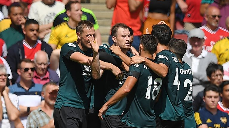 Ashley Barnes celebrates with teammates after scoring Burnley's equaliser