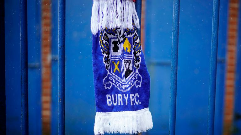 A scarf is tied to the fence of Gigg Lane, home of struggling League One club Bury FC