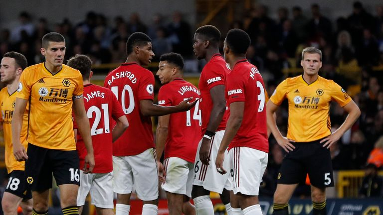 Marcus Rashford of Manchester United and Paul Pogba of Manchester United discuss who takes the penalty before Pogba missed during the Premier League match at Molineux, Wolverhampton. Picture date: 19th August 2019. Picture credit should read: Darren Staples/Sportimage via PA Images