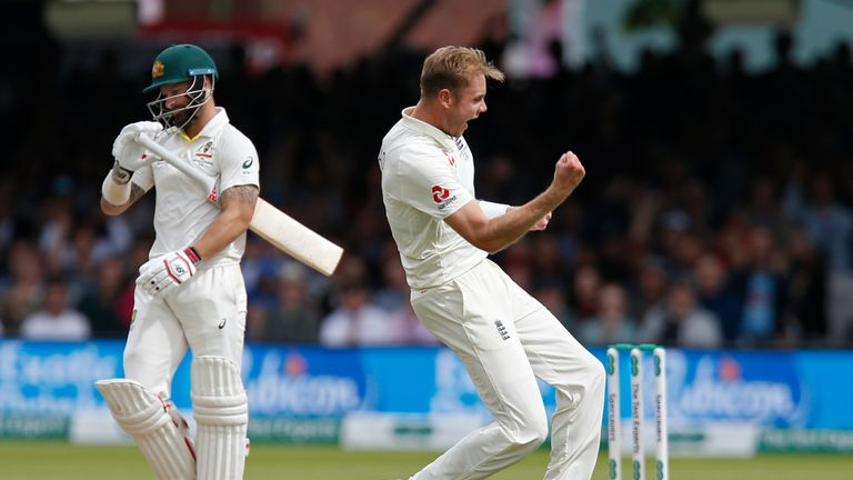 Stuart Broad celebrates after taking the wicket of Matthew Wade (L)