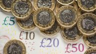 EMBARGOED TO 0001 MONDAY JULY 29 File photo dated 26/01/18 of bank notes and coins. The national living wage has helped increase the pay of self-employed workers even though they are not entitled to receive it, a new study suggests.