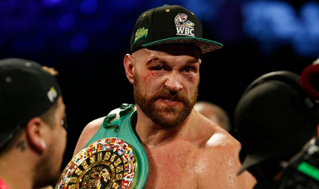 Tyson Fury overcomes bloodied eye to beat Otto Wallin on points