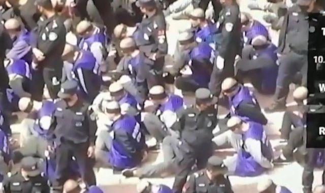 Uighurs detained in China: Australia attacks 'shackled prisoners' video