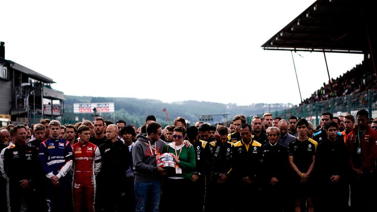 Brother and mother of BWT Arden's French driver Anthoine Hubert, relatives, drivers of F2 and team members observe a minute's silence before the start of the race of Formula3 on September 1, 2019, at the Spa-Francorchamps circuit in Spa the day of the Belgian Formula One Grand Prix. - French driver Anthoine Hubert, 22, was killed on August 31 in Spa in an accident during a Formula 2 race held on the sidelines of the F1 Grand Prix, according to organizers of the race. (Photo by Kenzo TRIBOUILLARD / AFP)        (Photo credit should read KENZO TRIBOUILLARD/AFP/Getty Images)
